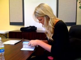Misti writing the check!